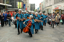 La banda Europa process through the streets of newcastle acompanied by a group of locally recruited snare drummers